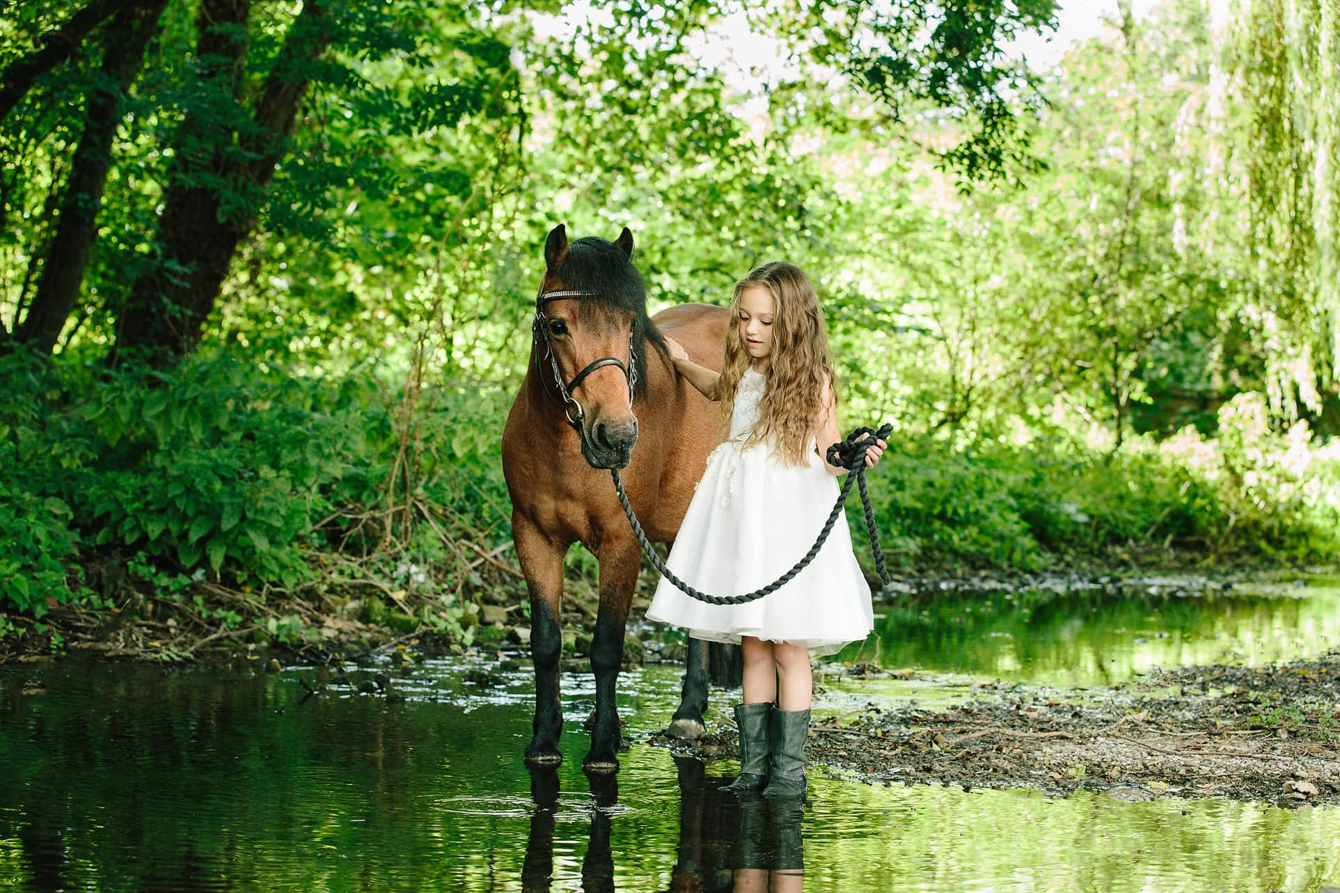 child horse photoshoot willow and stream